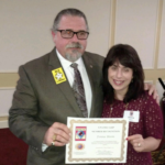 Donna Bloom with Cal Banyan receiving 5-Path Member Recognition, NGH 2016 Convention